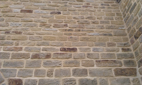 What is the difference between tuckpointing and repointing